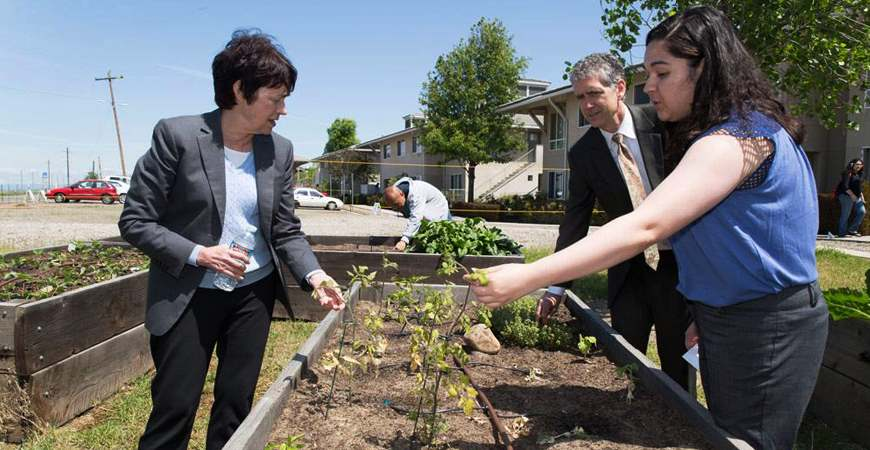 Chancellor Leland and Vice Chancellor Charles Nies visiting the SPROUTS farm