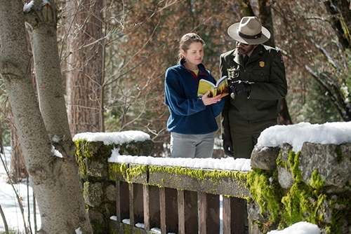 Shakespeare in Yosemite - actor and director conferring over script