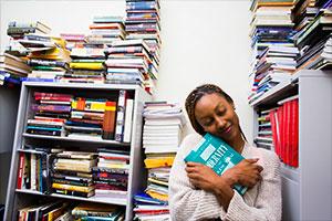 female student hugging a book