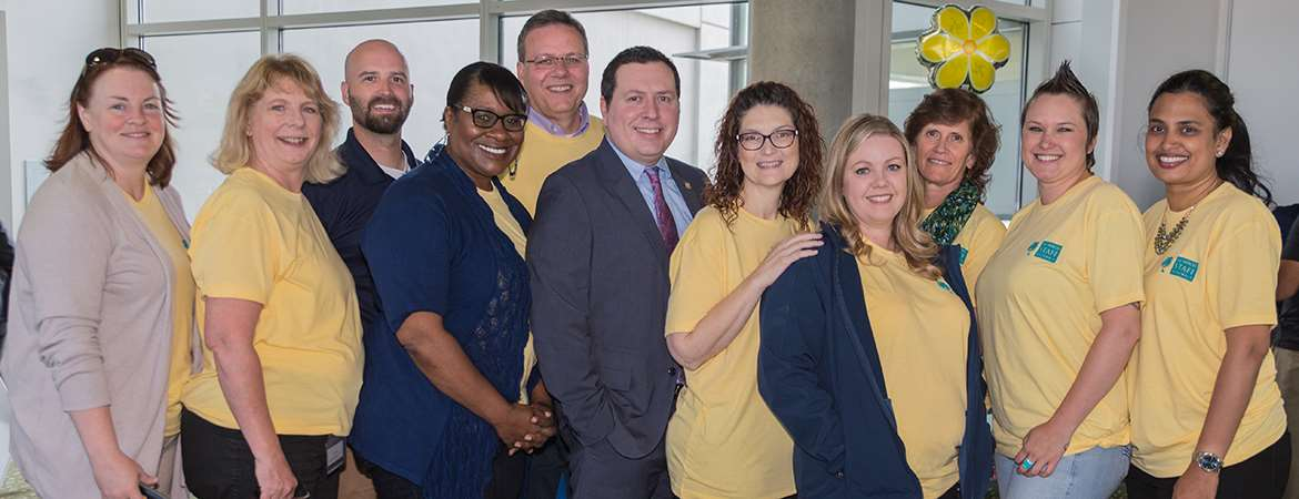 Ten staff members pose with UC Merced's AVC of Human Resources