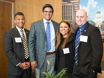 UC Merced alumni Donald Edwards, Janna Rodriguez and Keith Ellis with Assembly member Henry T. Perea
