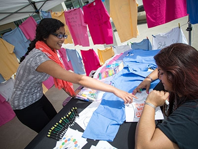 Students and others can participate in the Clothesline Project by writing personal messages relating to sexual assault and prevention on T-shirts.