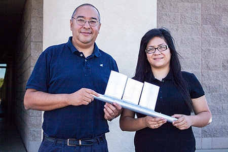 Professor Gerardo Diaz and student Azucena Robles show one piece of a mini channel panel.