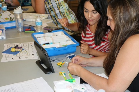 Educators learn topics including computer programming, Lego robotics, conductivity and circuits, math, and RNA and DNA.