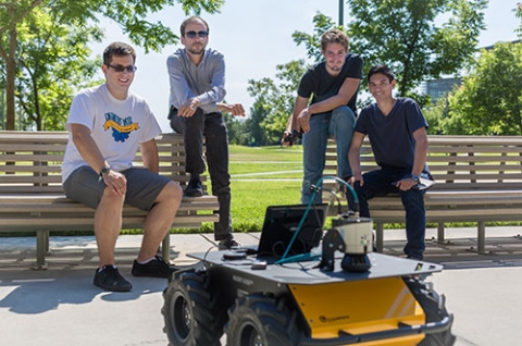 Professor Stefano Carpin, second from left, and his students show off their new robot.