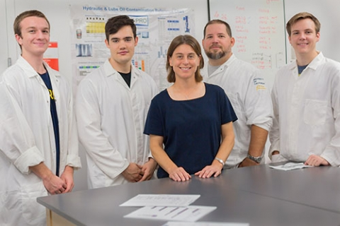 Professor Ashlie Martini, front, and her lab group, from left to right, undergraduate students Carter Brown and Nicholas Walters, graduate Student Sean Lantz and undergraduate student Cory Mercer, have a partnership with Chevron.