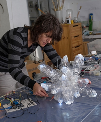 Diego works on an electronic piece of art for her upcoming exhibition in Merced. Photo by Carol Diego.