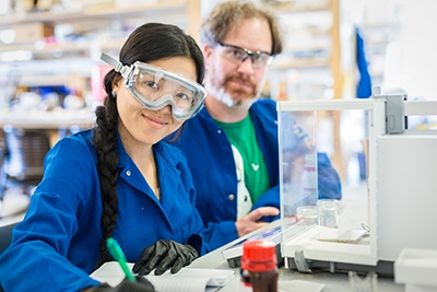 Mary Xiong, with Professor Erik Menke, is one of several local high school students gaining lab experience this summer.