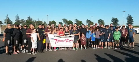 The Law Enforcement Torch Run to support Special Olympics passes through campus.
