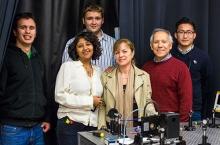 From left, students Joseph Silva and Seth Spitulski stand behind Professor Sai Ghosh, STEM Resource Center Coordinator Petia Gueorguieva, School of Natural Sciences Dean Juan Meza and student John Harvey Paredes, all part of the nanoBIO internship program.
