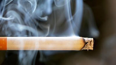 A lit cigarette is seen in an undated image.