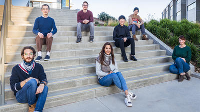 Chemistry Professor Tao Ye and his students gathered on campus.