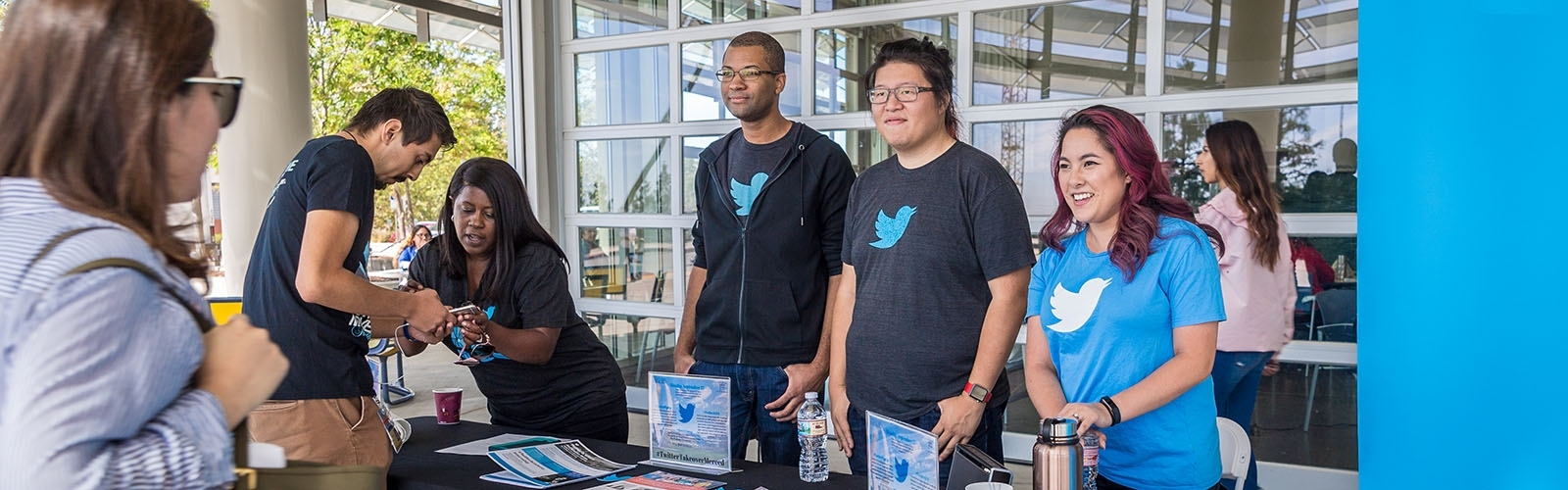 Twitter staff greet students at a hiring event